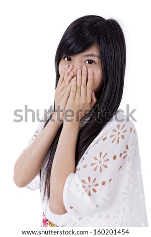 Young asian woman covering her mouth with her hand  - stock photo