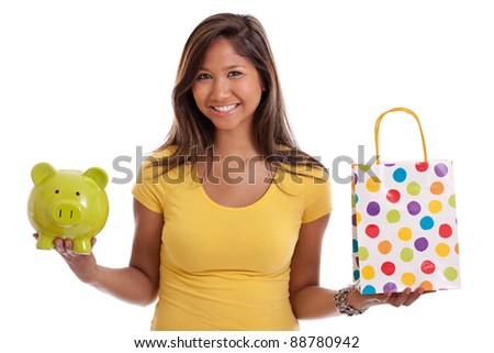 Young Asian woman deciding whether to shop or save isolated on a white background - stock photo
