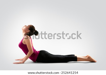 Young asian woman doing yoga, Isolated on grey background