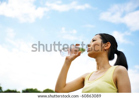young asian woman drinking water - stock photo