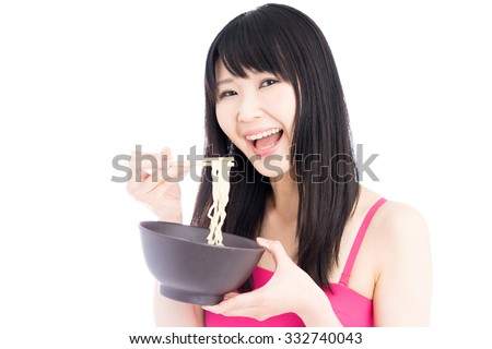 Young Asian woman eating noodles isolated on white background