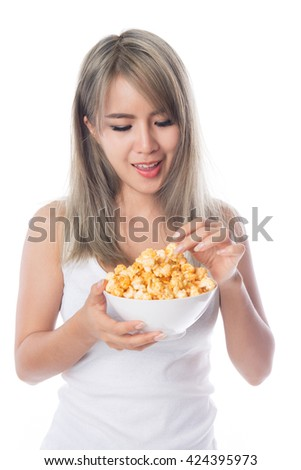 Young asian woman eating popcorn, isolated on white background.