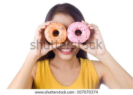 Young asian woman enjoy eating couple of  sweet colorful donut on white background - stock photo