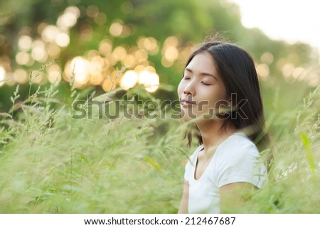 Young Asian woman enjoying a day in nature.