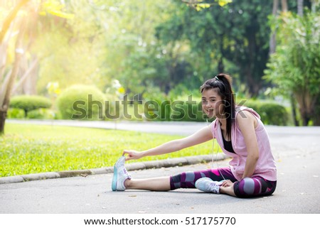 Young Asian woman,exercising in the park background.