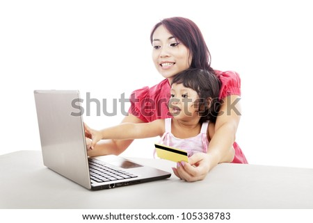 Young asian woman gives online shopping education to her daughter
