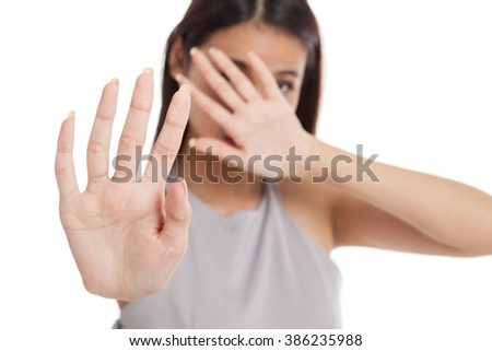 Young Asian woman  hide her  face focus at hand  isolated on white background