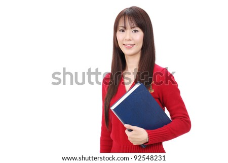 Young asian woman holding a book isolated on white background