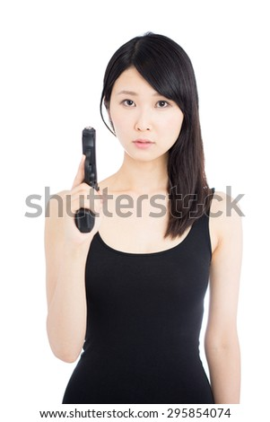young Asian woman holding a hand gun isolated on white background - stock photo