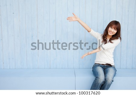 Young Asian woman holding hands with space for copy - stock photo