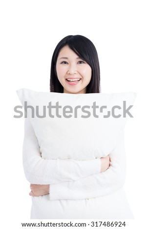 Young Asian woman holding pillow isolated on white background