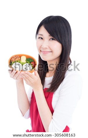 young Asian woman holding school lunch for kids isolated on white background