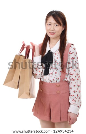 Young asian woman holding shopping bags isolated no white background - stock photo