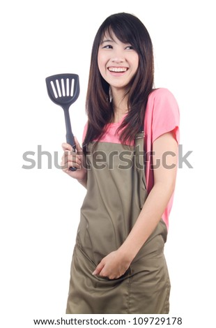 Young asian woman housewife on white background - stock photo