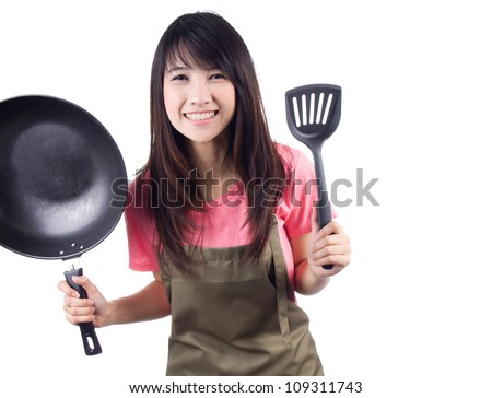 Young asian woman housewife with pan and  apron on white background