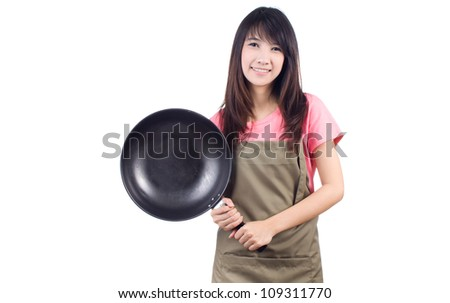 Young asian woman housewife with pan and  apron on white background - stock photo