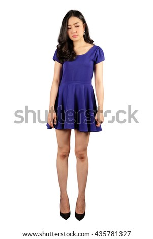 Young asian woman in blue dress looking at the space for text on white blue background with clipping path
