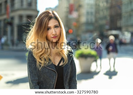 Young Asian woman in city portrait face