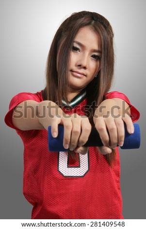 young asian woman in fitness clothes and dumbbell