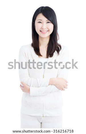 Young Asian woman in pajamas isolated on white background