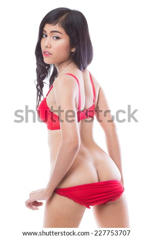 Young asian woman in red lingerie, showing sexy ass on white background