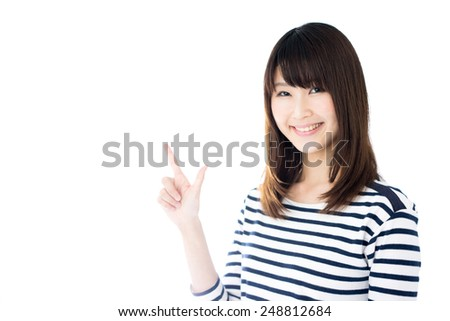 young Asian woman in striped clothing showing copy space, isolated on white background - stock photo