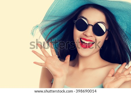 Young Asian woman in sunglasses with expression of surprise , vintage color tone. - stock photo