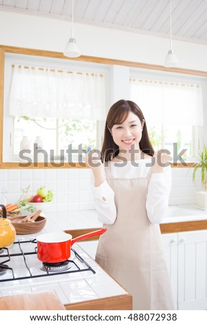 young asian woman in the kitchen?