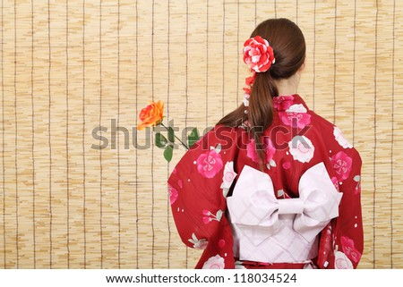 Young asian woman in traditional clothes of kimono - stock photo