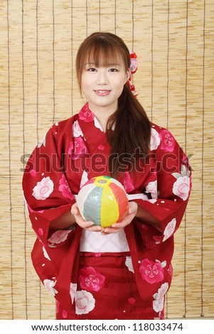 Young asian woman in traditional clothes of kimono with paper balloon - stock photo