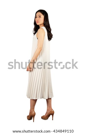 Young asian woman in white dress looking at the camera on white isolate with clipping path - stock photo