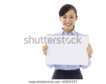 Young asian woman is holding empty text board over white background - stock photo