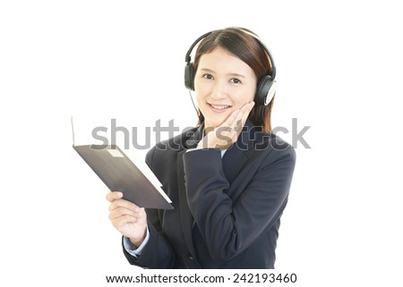 Young Asian woman listening to music.