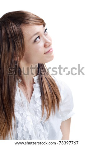 Young Asian woman looking at side, on white background - stock photo