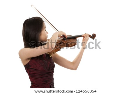 young asian woman plaiyng the violin on white background - stock photo