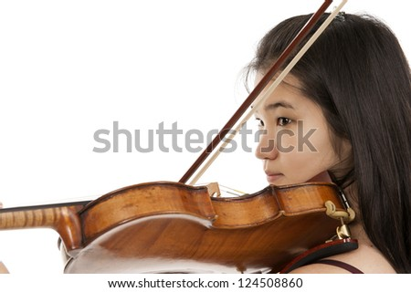 young asian woman playing the violin on white background - stock photo