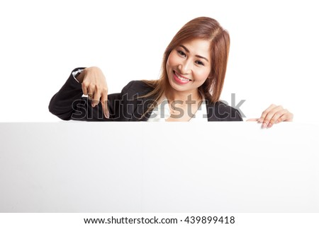 Young Asian woman point to a  blank sign  isolated on white background