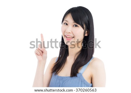 Young Asian woman pointing copy space, isolated on white background