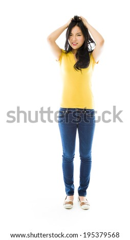 Young Asian woman pulling her hair and screaming in frustration - stock photo