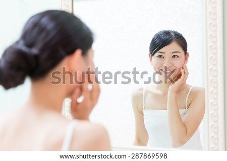 young asian woman relaxing in the bathroom - stock photo