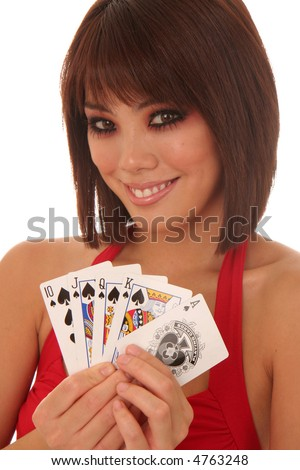 Young Asian woman revealing a royal flush