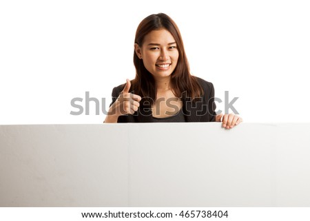 Young Asian woman show thumbs up with blank sign  isolated on white background.