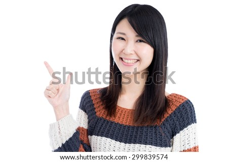 young Asian woman showing copy space isolated on white background - stock photo
