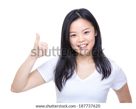 Young asian woman showing thumb up