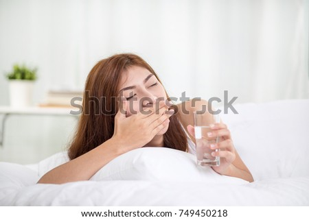 Young asian woman sleeping in her bed at night, she is resting with eyes closed.