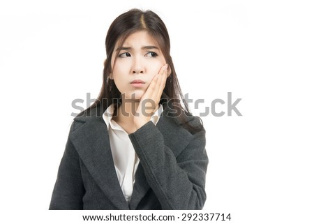 Young asian woman suffering from toothache,sensitive tooth ache with blank copy space,Portrait of beautiful Asian woman,Thai girl,Negative human emotion facial expression,isolated on white background - stock photo