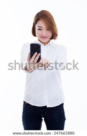 Young Asian woman take picture withe smart phone isolated on white background.