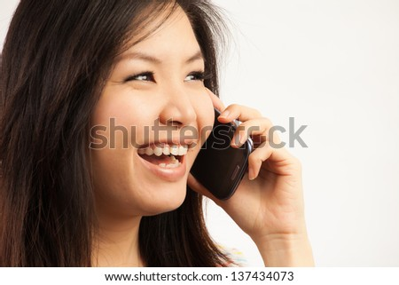 Young Asian woman talking to the phone