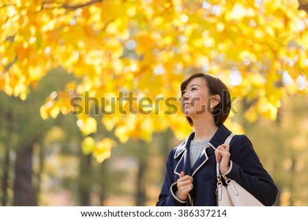 Young Asian woman under the plane tree. - stock photo