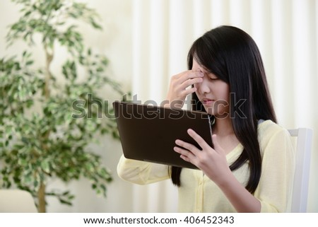 young asian Woman use  tablet.